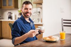 Latin man texting over breakfast Stock Images