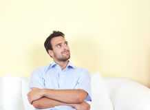 Latin man thinking on the sofa Stock Photos