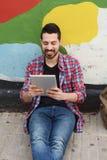 Latin man using a tablet. Stock Photography