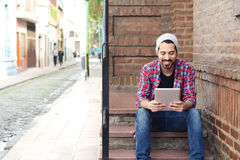 Latin man using a tablet. Royalty Free Stock Photos