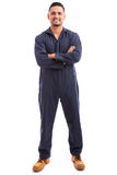 Latin mechanic wearing overalls Royalty Free Stock Image