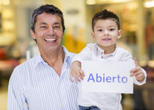 Man and son with an open sign Royalty Free Stock Photos