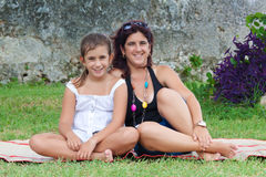 Latin mother and daughter in a park Royalty Free Stock Photography