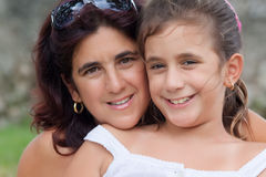 Latin mother and daughter smiling outdoors Stock Images