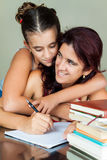 Latin mother and daughter studying Stock Photos