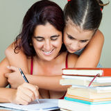 Latin mother and daughter studying Royalty Free Stock Images
