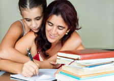 Latin mother and daughter studying at home Stock Image