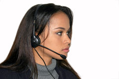 Latin operator II. Beautiful latin operator with headset Royalty Free Stock Photography