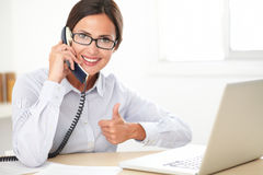 Latin receptionist talking on the phone Royalty Free Stock Photo