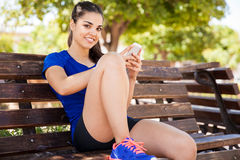 Latin runner using a smartphone Royalty Free Stock Photography