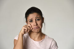 Latin sad woman serious and concerned crying desperate overacting on feeling depressed. Young beautiful latin sad woman serious and concerned crying desperate Stock Images