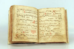 Latin songbook. An old hand-writen latin songbook stock photo