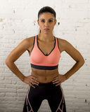 Latin sport woman posing in fierce and badass face expression with fit slim body Stock Image