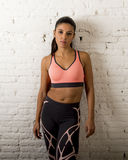 Latin sport woman posing in fierce and badass face expression with fit slim body Royalty Free Stock Photography