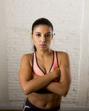 Latin sport woman posing in fierce and badass face expression with fit slim body stock photos