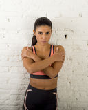 Latin sport woman posing in fierce and badass face expression with fit slim body Stock Images