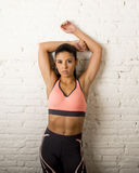 Latin sport woman posing in fierce and badass face expression with fit slim body Royalty Free Stock Photos
