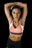 Latin sport woman posing in fierce and badass face expression with fit slim body Royalty Free Stock Image