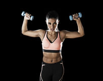 Latin sport woman posing in fierce expression holding dumbbell. Young attractive latin sport woman posing in fierce and badass face expression holding dumbbell Stock Images