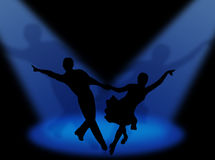 Latin in the spotlights. Couple dancing latin dance in the spotlight Royalty Free Stock Images