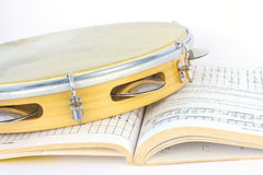Latin tambourine and music score Royalty Free Stock Photo