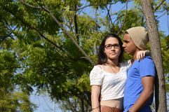 Latin teen couple with emotions, outdoors Stock Photo