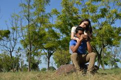 Latin teen couple with emotions, outdoors Royalty Free Stock Photography