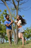 Latin teen couple with emotions, outdoors Royalty Free Stock Image