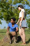 Latin teen couple with emotions, outdoors Stock Image