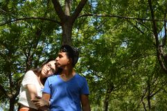 Latin teen couple with emotions, outdoors Stock Images