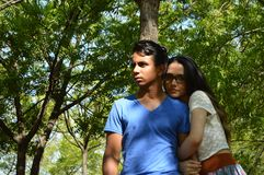 Latin teen couple with emotions, outdoors Stock Photography
