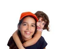 Latin teen hispanic girl with little friend Stock Image