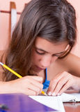Latin teen working on her school project Royalty Free Stock Image
