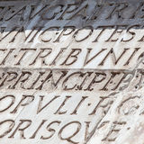 Latin type. Latin serif type carved in marble Stock Photography