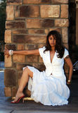 Latin Woman. Beautiful Woman posing in a white dress royalty free stock photo