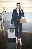 Latin woman calling at airport Royalty Free Stock Photo