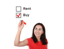 Latin woman choosing buy or rent new house option in real estate concept. Latin woman choosing buy to rent option ticking buying box with red marker on glass Royalty Free Stock Photography