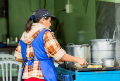 Latin Woman Cooking On The Street Stock Photography