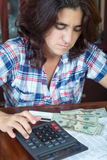 Latin woman counting money at home to pay the bills Royalty Free Stock Photos