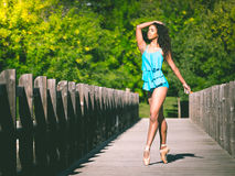 Latin woman dancer on the tip of her ballet slippers Stock Images