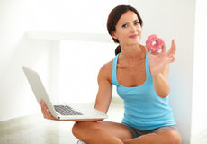 Latin woman on diet working in her laptop Royalty Free Stock Images