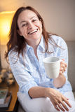 Latin woman drinking coffee Royalty Free Stock Photos