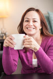 Latin woman drinking coffee Stock Photos