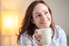 Latin woman drinking coffee Royalty Free Stock Photography