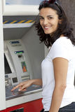 Latin woman enters the PIN number at the ATM Royalty Free Stock Images