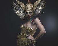 Latin woman with green hair and gold costume with handmade flour royalty free stock photo
