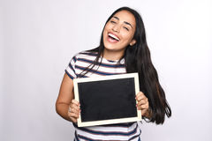 Latin woman holding chalkboard. Portrait of latin woman holding chalkboard. Isolated white background Stock Photos