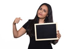 Latin woman holding chalkboard. Portrait of latin woman holding chalkboard. Isolated white background Royalty Free Stock Images