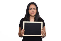 Latin woman holding chalkboard. Portrait of latin woman holding chalkboard. Isolated white background Stock Image