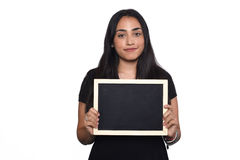 Latin woman holding chalkboard. Portrait of latin woman holding chalkboard. Isolated white background Royalty Free Stock Photos
